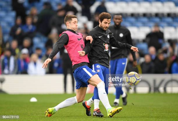 Gary Cahill tackles Cesc Fabregas of Chelsea during the warm up prior to the Premier League match between Chelsea and Leicester City at Stamford...