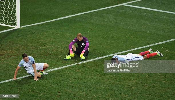 Gary CahillJoe Hart and Dele Alli of England show their dissapointment after defeat during the UEFA Euro 2016 Round of 16 match between England and...