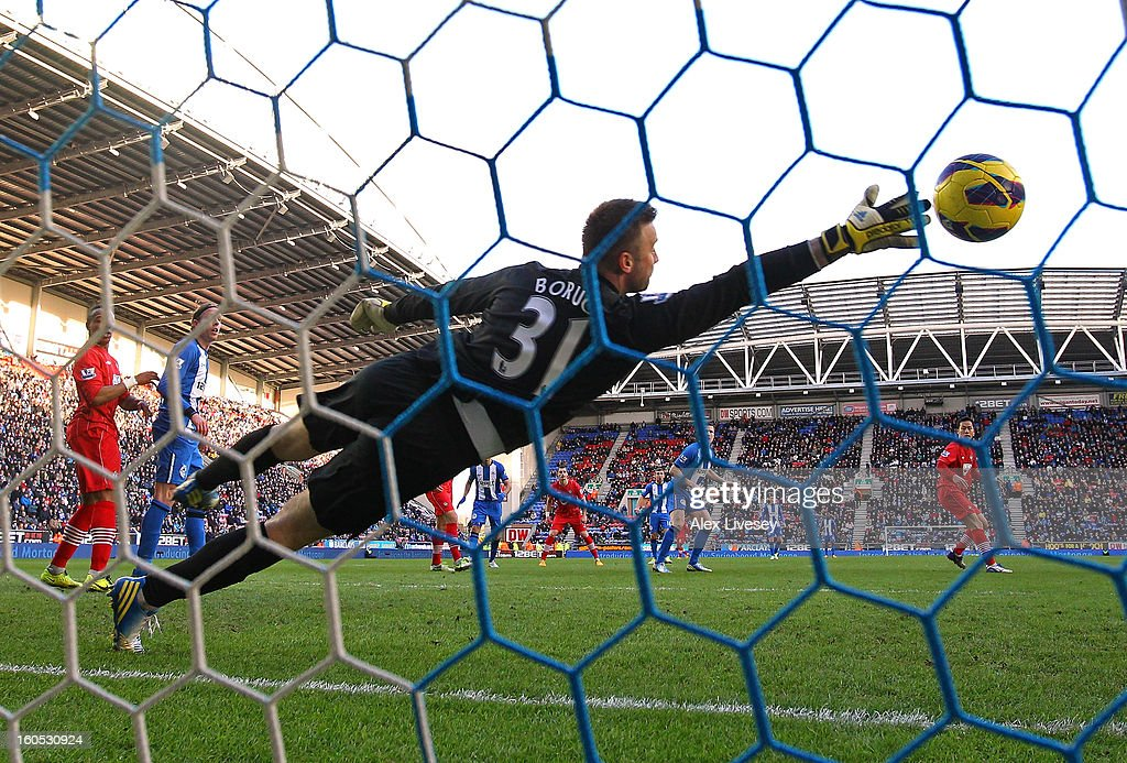 Gary Caldwell of Wigan Athletic scores the opening goal past Artur Boruc of Southampton during the Barclays Premier League match between Wigan Athletic and Southampton at DW Stadium on February 2, 2013 in Wigan, England.