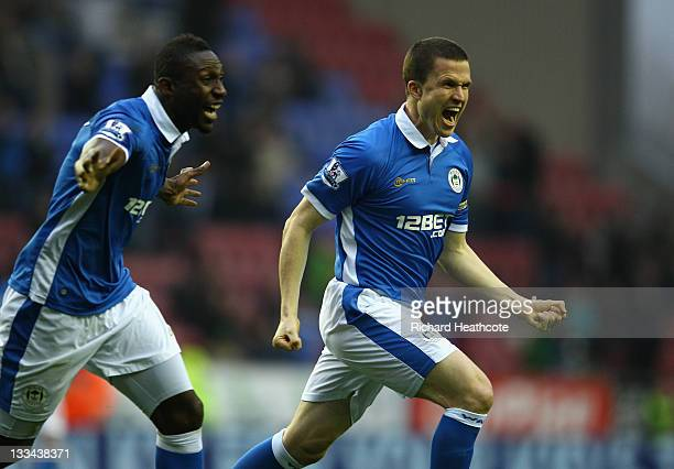 Gary Caldwell of Wigan celebrates scoring with a header during the Barclays Premier League match between Wigan Athletic and Blackburn Rovers at the...