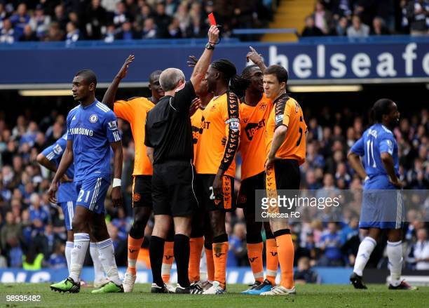 Gary Caldwell of Wigan is sent off by Referee Martin Atkinson after bringing down Frank Lampard of Chelsea for a penalty during the Barclays Premier...