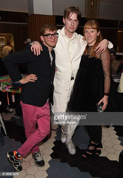 Gary Card Alex Mullins and Molly Goddard attend 'Hanging Out In Hell At Hoi Polli' at Ace Hotel on October 31 2016 in London England