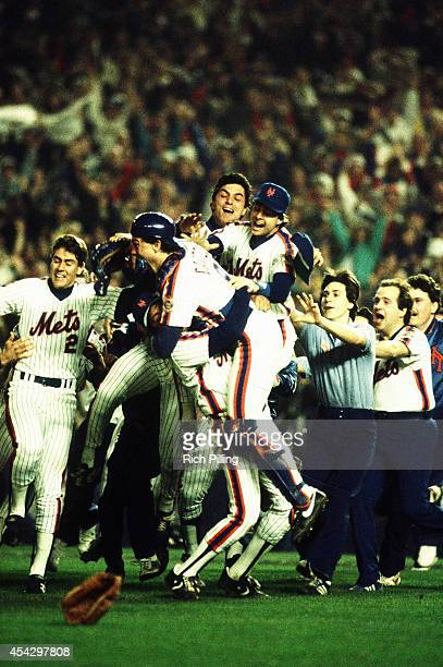 Gary Carter and The New York Mets team celebrates their victory during World Series game seven between the Boston Red Sox and New York Mets on...