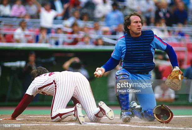 Gary Carter of the Montreal Expos looks on after making a play on the runner at home plate against the Philadelphia Phillies during an Major League...