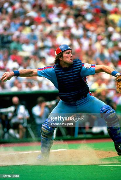 Gary Carter of the Montreal Expos looks to throw out the runner against the Philadelphia Phillies during an Major League Baseball game circa 1982 at...