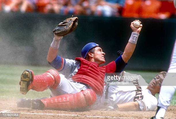 Gary Carter of the Montreal Expos tags out Kirt Manwaring of the San Francisco Giants during an Major League Baseball game at Candlestick Park circa...