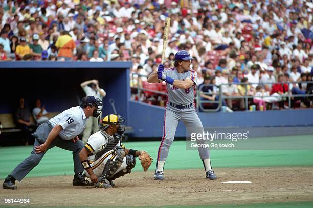 Gary Carter of the New York Mets bats as catcher Tony Pena of the Pittsburgh Pirates and umpire Terry Tata look on during a Major League Baseball...