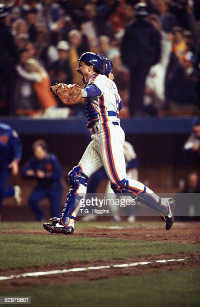 Gary Carter of the New York Mets celebrates the final out of Game seven of the 1986 World Series against the Boston Red Sox at Shea Stadium on...