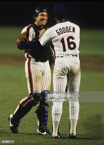Gary Carter of the New York Mets congratulates Dwight Gooden of the New York Mets after a MLB game in Shea Stadium in August 1985 in Flushing New York