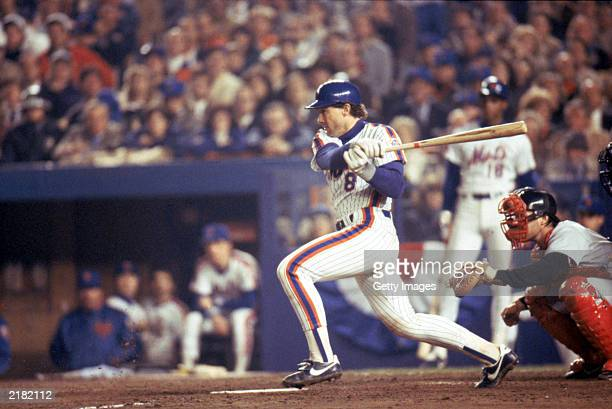 Gary Carter of the New York Mets swings at the pitch during the 1986 World Series game against the Boston Red Sox in October 1986 at Shea Stadium in...