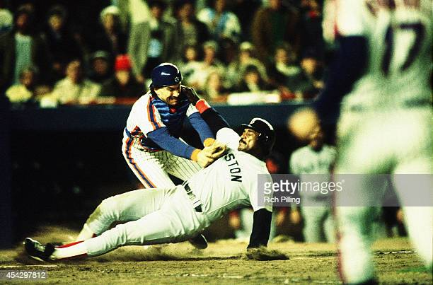 Gary Carter of the New York Mets tags out Jim Rice at home plate during World Series game seven between the Boston Red Sox and New York Mets on...
