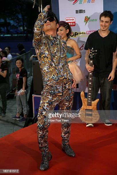 Gary Chow of Malaysia poses during the red carpet prior to the start of the 13th Global Chinese Music Awards at Putra Stadium on October 5 2013 in...