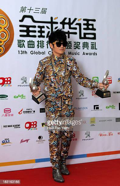Gary Chow of Malaysia poses with his Awards at back stage during the 13th Global Chinese Music Awards at Putra Stadium on October 5 2013 in Kuala...