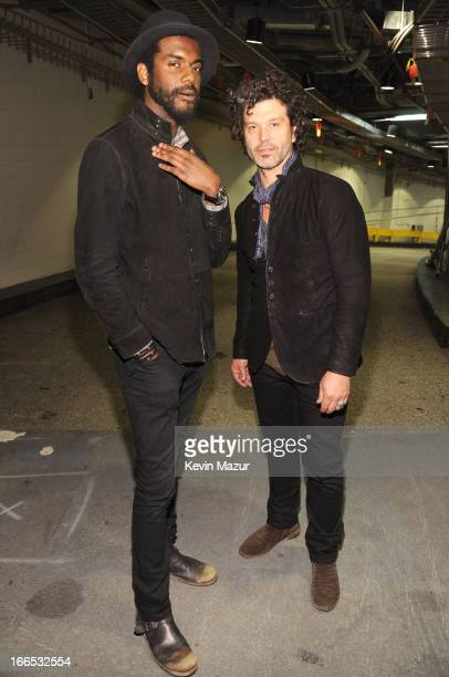 Gary Clark Jr and Doyle Bramhall pose backstage during the 2013 Crossroads Guitar Festival at Madison Square Garden on April 13 2013 in New York City