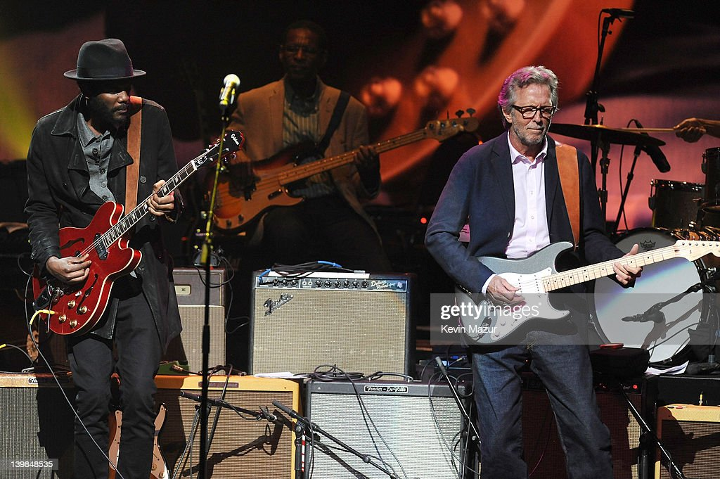 Gary Clark Jr and Eric Clapton perform on stage during Howlin For Hubert: A Concert to Benefit the Jazz Foundation of America at The Apollo Theater on February 24, 2012 in New York City.
