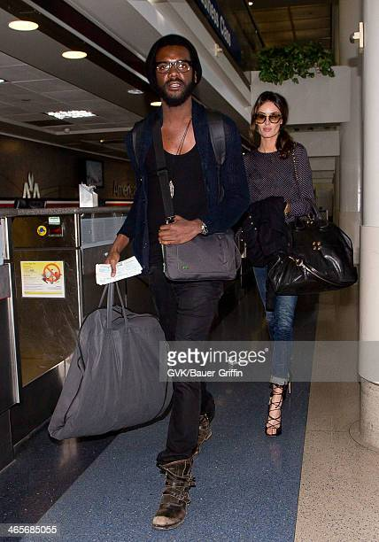 Gary Clark Jr and Nicole Trunfio are seen at Los Angeles International Airport airport on January 28 2014 in Los Angeles California