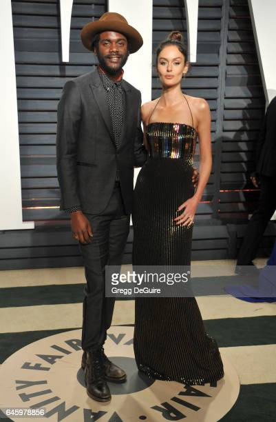Gary Clark Jr and Nicole Trunfio arrive at the 2017 Vanity Fair Oscar Party Hosted By Graydon Carter at Wallis Annenberg Center for the Performing...