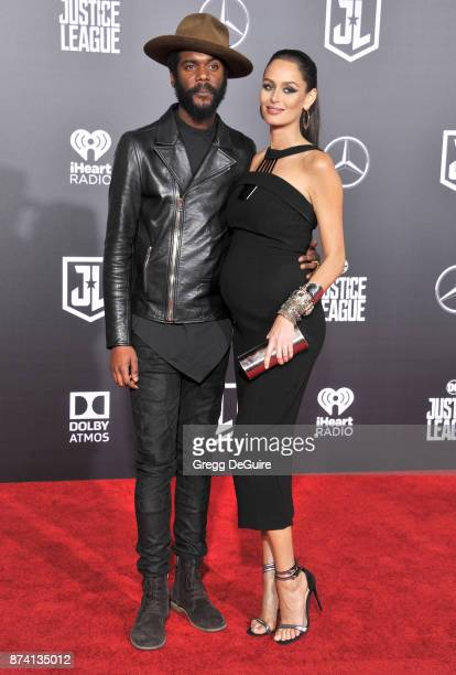 Gary Clark Jr and Nicole Trunfio arrive at the premiere of Warner Bros Pictures' Justice League at Dolby Theatre on November 13 2017 in Hollywood...