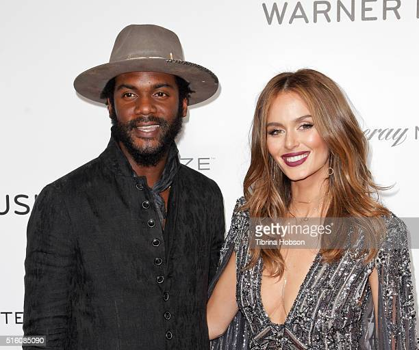 Gary Clark Jr and Nicole Trunfio attend Warner Music Group's annual Grammy celebration at Milk Studios on February 15 2016 in Los Angeles California