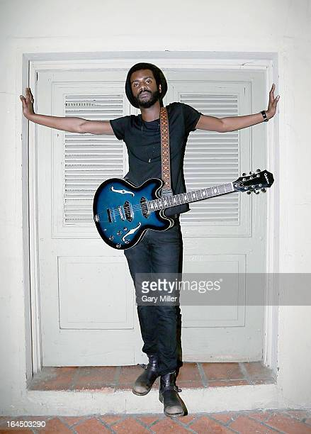 Gary Clark Jr poses backstage with his custom 'Blak Blu' Epiphone Casino honoring the release of his new CD of the same name after performing in...