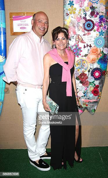 Gary Cohn and Lisa PevaroffCohn attend the 2016 Hamptons Paddle Party for Pink at Fairview on Mecox Bay on August 6 2016 in Bridgehampton New York