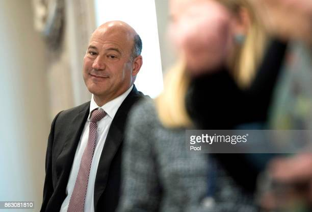 Gary Cohn Director of the National Economic Council listens as President Donald Trump speaks with Governor Ricardo Rossello of Puerto Rico during a...