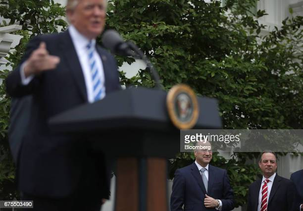 Gary Cohn director of the US National Economic Council center and Reince Priebus White House chief of staff listen while US President Donald Trump...