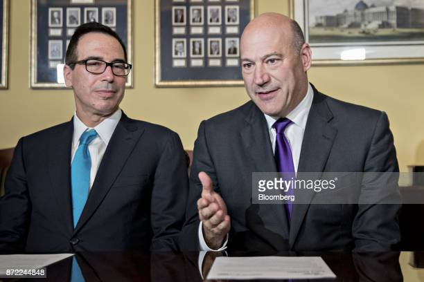 Gary Cohn director of the US National Economic Council right speaks as Steven Mnuchin US Treasury secretary listens during a meeting with members of...
