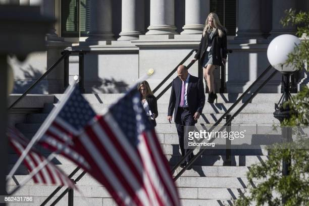 Gary Cohn the director of the US National Economic Council center leaves the Eisenhower Executive office building in Washington DC US on Tuesday Oct...