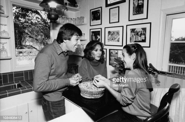Gary Collins actor and wife Mary Ann Mobley former Miss America with daughter Clancy in the kitchen December 9th 1980