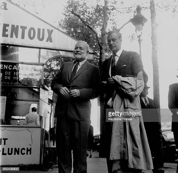 Gary Cooper and Ernest Hemingway leaving a Parisian movie theater, both are avid hunters, they had just seen a movie on wildcat hunting, 1956 in...