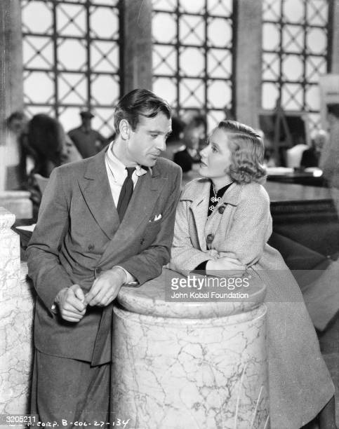 Gary Cooper as the eponymous hero strikes up a conversation with Jean Arthur as the conniving Babe Bennett in 'Mr Deeds Goes to Town' directed by...