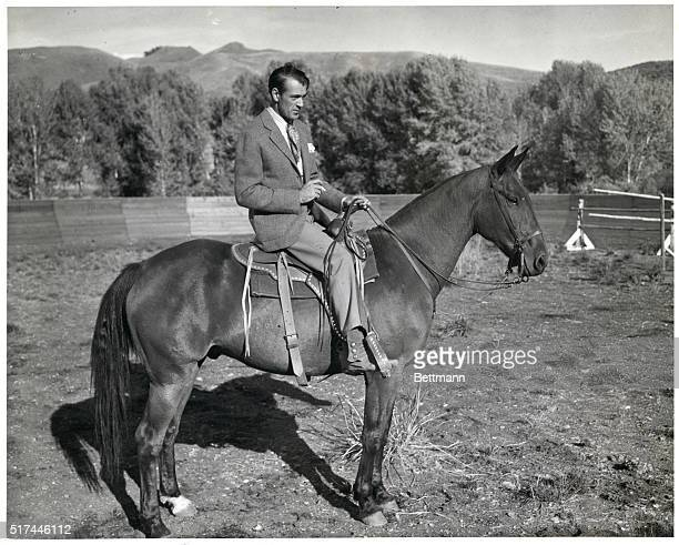Gary Cooper at Sun Valley is shown using the saddle he rode in The Cowboy and the Lady Undated photograph