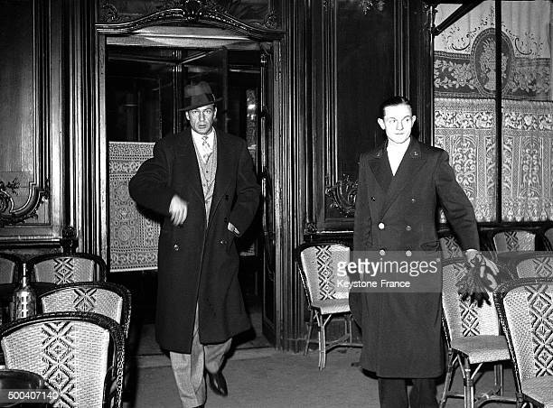 Gary Cooper is leaving a great Parisian restaurant in la Madeleine after having had a dinner there with his wife Sandra Shaw on November 16 1938 in...