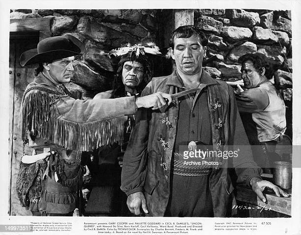 Gary Cooper putting knife to neck of Mike Mazurki in a scene from the film 'Unconquered' 1947