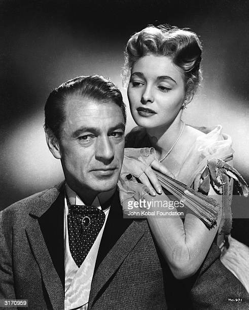 Gary Cooper stars as tobacco farmer Brant Royle and Patricia Neal as his embittered wife Margaret in 'Bright Leaf', directed by Michael Curtiz.