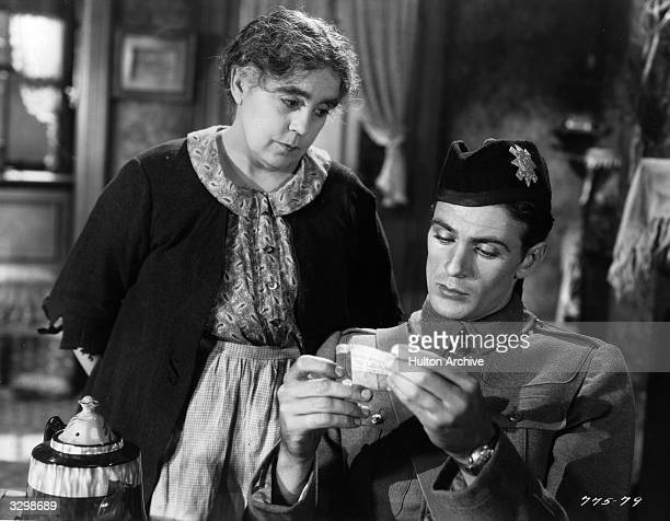 Gary Cooper stars with Beryl Mercer in the film 'Medals' , in which a London charlady adopts a soldier. The film was directed by Richard Wallace for...