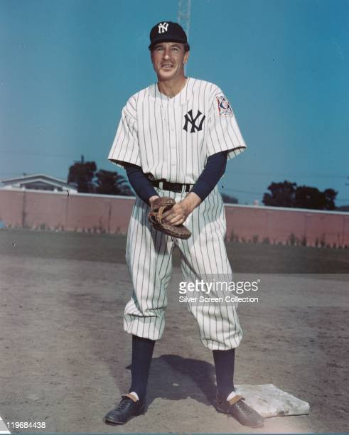Gary Cooper , US actor, wearing a New York Yankees baseball kit and a catcher's mitt in a publicity portrait issued for the film, 'The Pride of the...