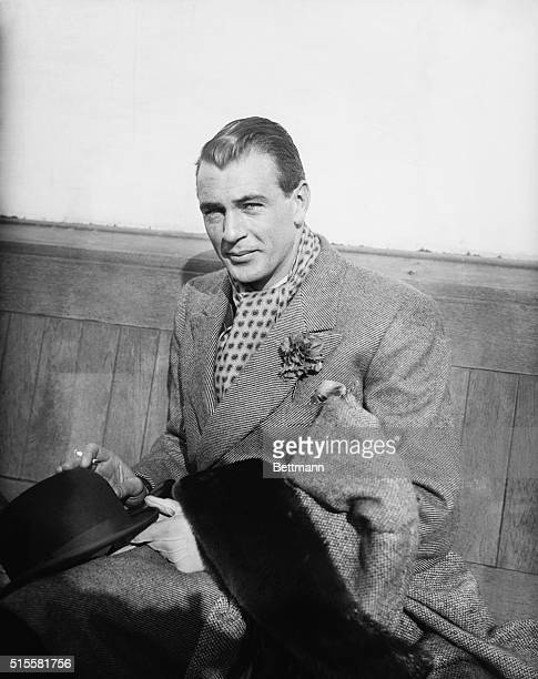 Gary Cooper, well-known motion picture star, is seen aboard U.S.S. Europa as he arrive in New York on April 1st., after enjoying a big game hunt....