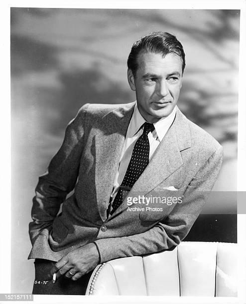 Gary Cooper with cigarette in publicity portrait, Circa 1950.