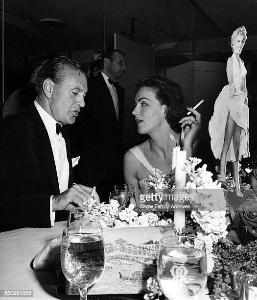 """Gary Cooper with Hjordis Tersmeden, wife of actor David Niven, at the wrap party for the filming of """"The Seven Year Itch"""" at Romanoff's Restaurant in..."""
