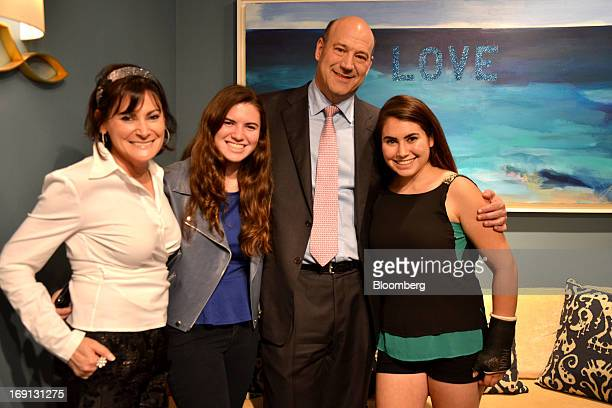 Gary D Cohn president and chief operating officer of Goldman Sachs Group Inc stands with Cohn family members Lisa PevaroffCohn from left Chelsea and...
