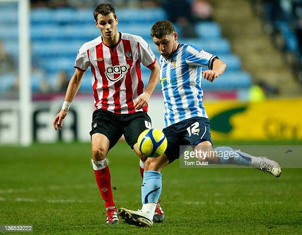Gary Deegan of Coventry City battles for the ball with Morgan Schneiderlin of Southampton during the FA Cup 3rd round match between Coventry City and...