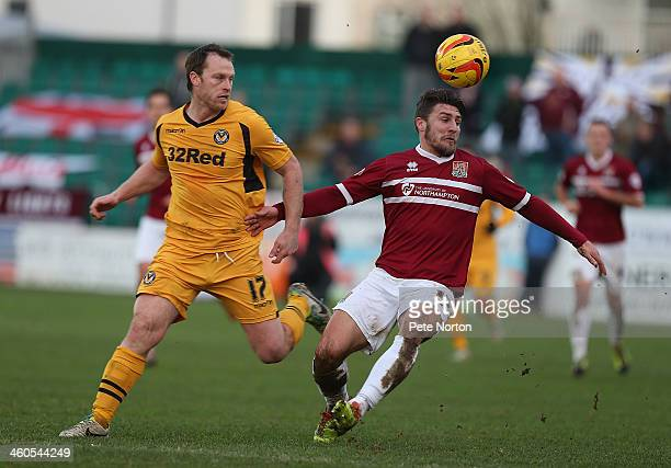 Gary Deegan of Northampton Town contests the ball with Mike Flynn of Newport County during the Sky Bet League Two match between Newport County and...