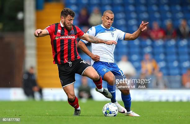 Gary Deegan of Shrewsbury Town and James Vaughan of Bury during the Sky Bet League One match between Bury and Shrewsbury Town at Gigg Lane on...