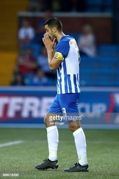 Gary Dicker of Kilmarnock FC reacts after missing his shot in the penalty shoot out during the Betfred Scottish League Cup match between Kilmarnock...