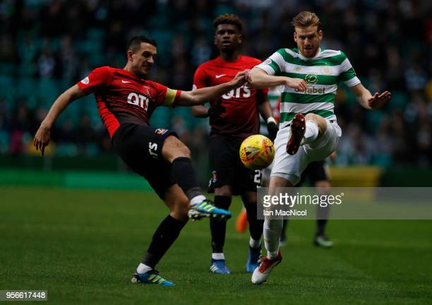 Gary Dicker of Kilmarnock vies with Stuart Armstrong of Celtic during the Scottish Premier League between Celtic and Kilmarnock at Celtic Park on May...