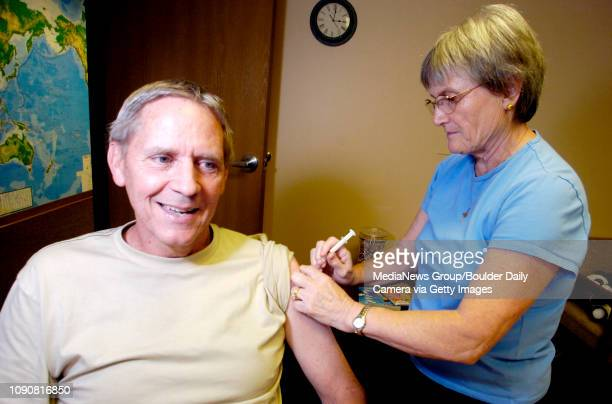 Gary Dickinson get a hepatitis B booster shot from Eilish McCafferty RN at Passport Health in Boulder Colorado July 16 2007 Dickinson is getting his...