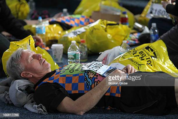 Gary Dionn of Amherst NH sleeps in the Masonic Hall in downtown Hopkinton before the race The Children's Hospital team prepares for the 117th Boston...