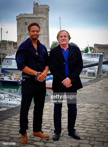 Gary Dourdan poses with Quentin Raspail Chairman of the Festival during the photocall at the 15th Festival of TV Fiction on September 13 2013 in La...